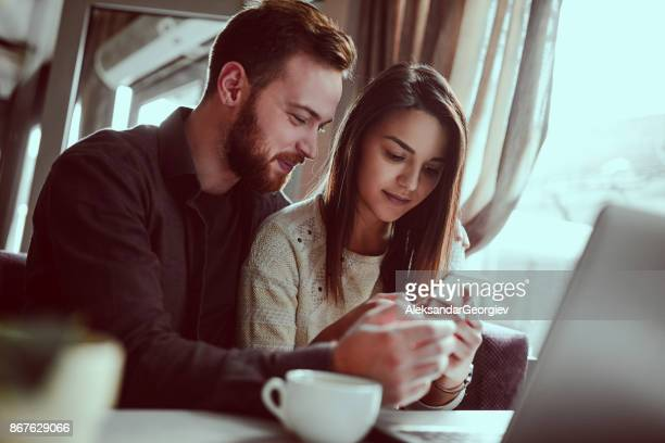 Serious Girl Reading Boyfriends Text Messages on Mobile Phone