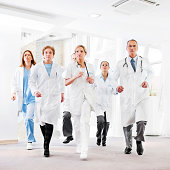 Serious group of doctors running