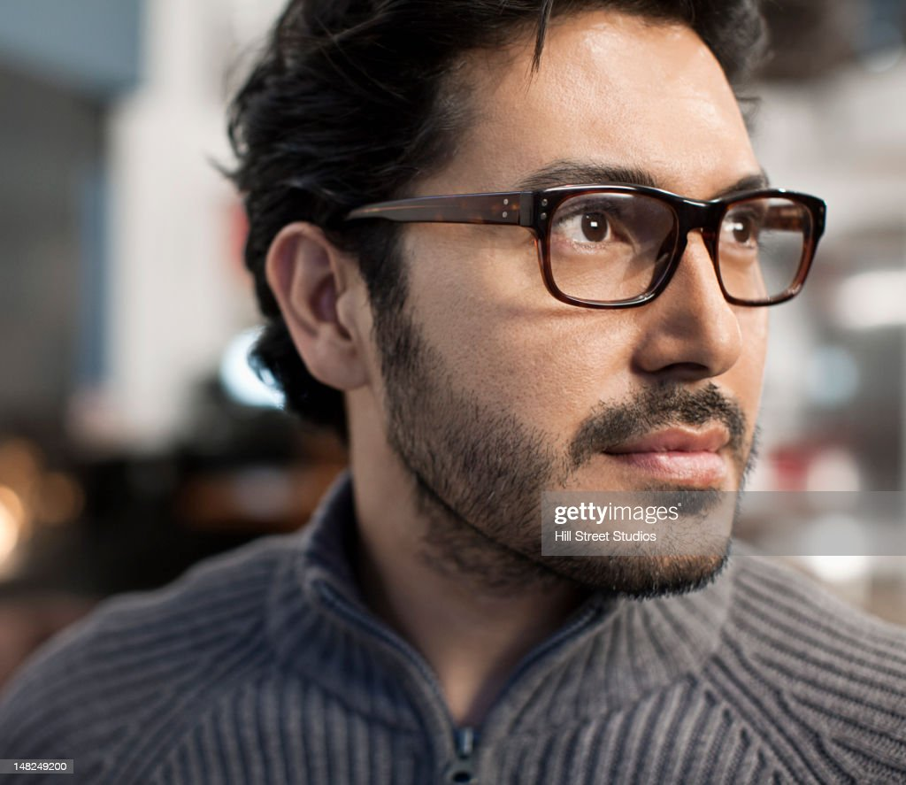 Serious Hispanic man : Stock Photo