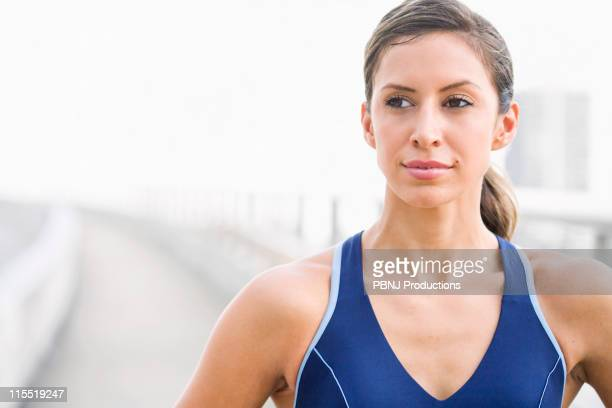 Serious Hispanic woman in sportswear