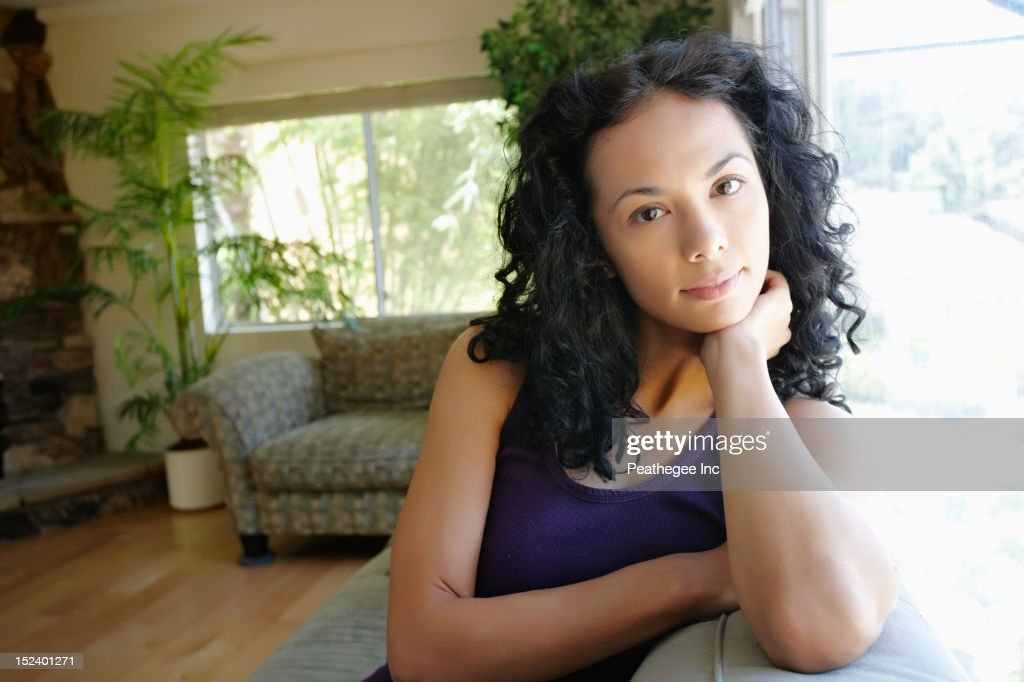 Serious Hispanic woman : Stock Photo