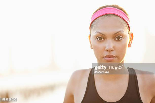Serious Hispanic woman wearing headband