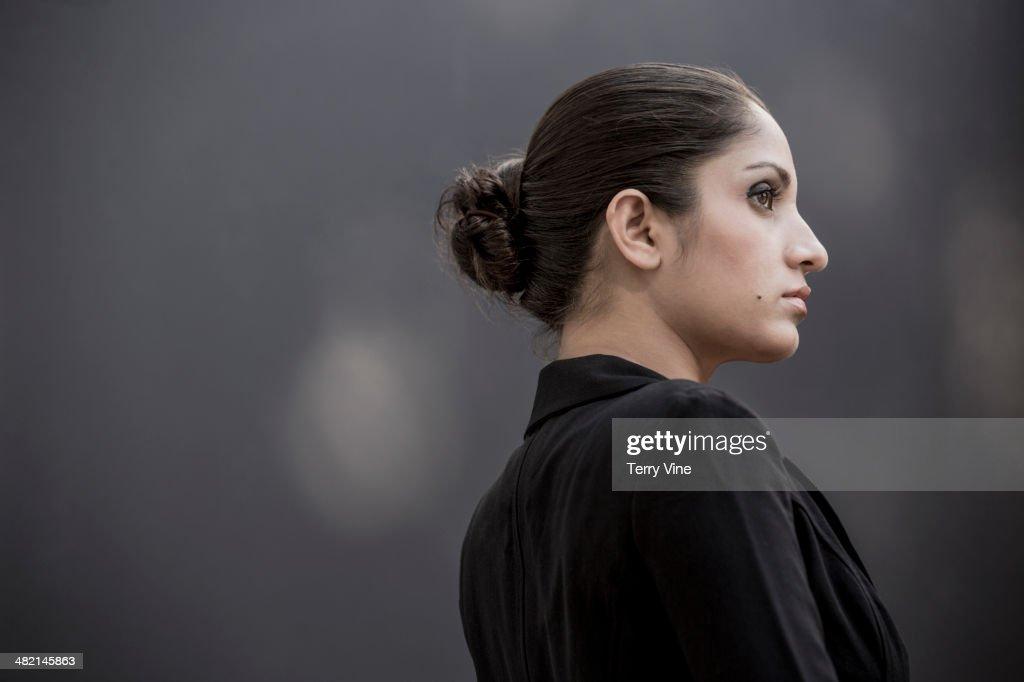 Serious Indian woman looking away : Stock Photo
