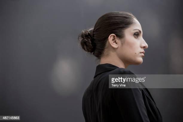 Serious Indian woman looking away