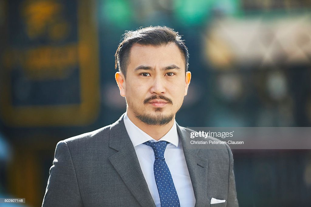 Serious looking Chinese businessman in suit and tie