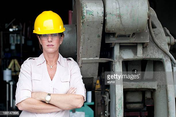 Serious Looking Female Manufacturing Employee