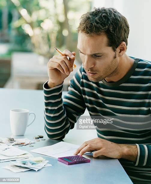 Serious Looking Man Examining a Bill