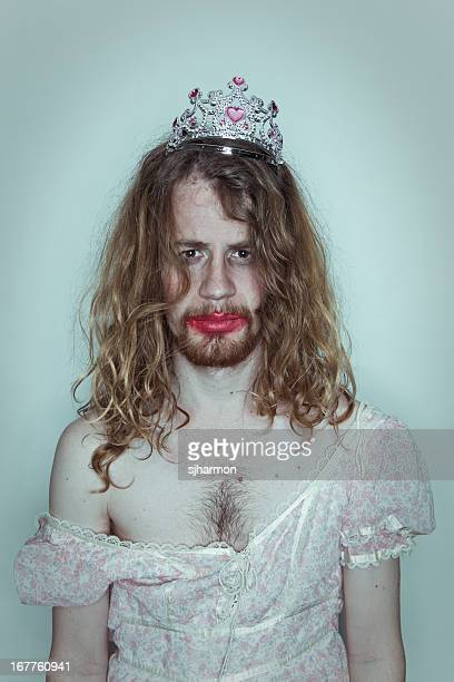 Serious Male Prom queen in drag tiara on head lipstick