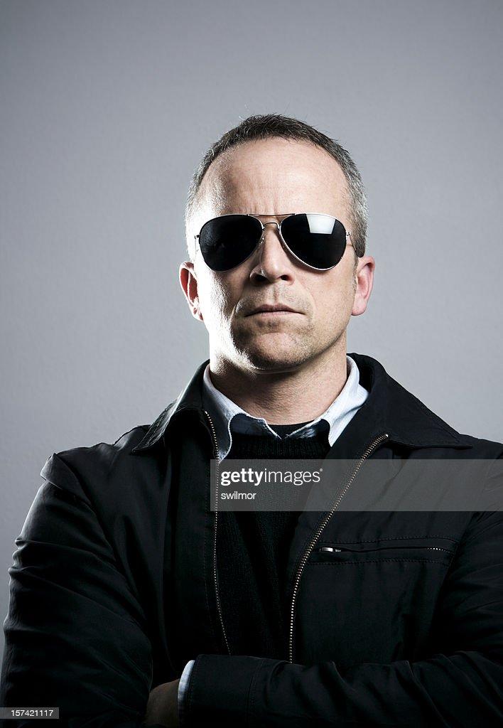Serious Man in Sunglasses