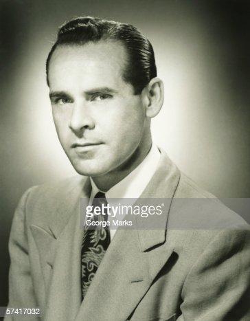 Serious man posing in studio, (B&W), (Close-up), (Portrait) : Stock Photo