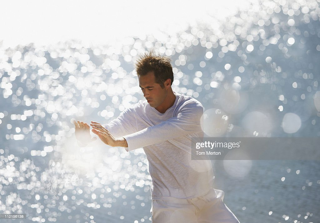 Serious man practicing tai chi : Stock Photo