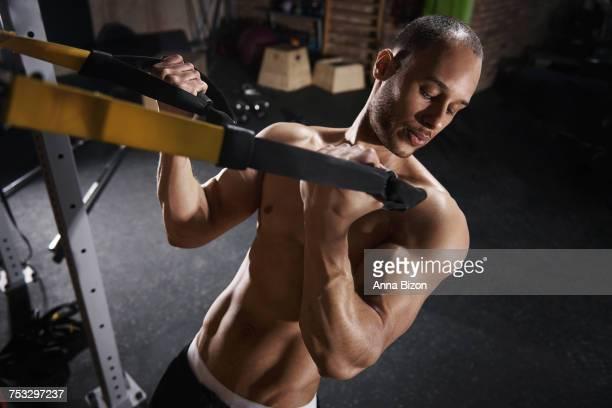 Serious man stretching with pilates machine. Mielec, Poland