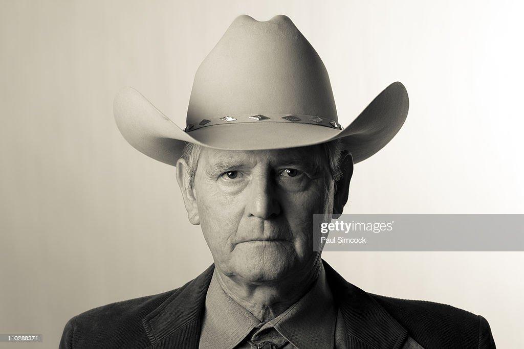 Serious man wearing cowboy hat