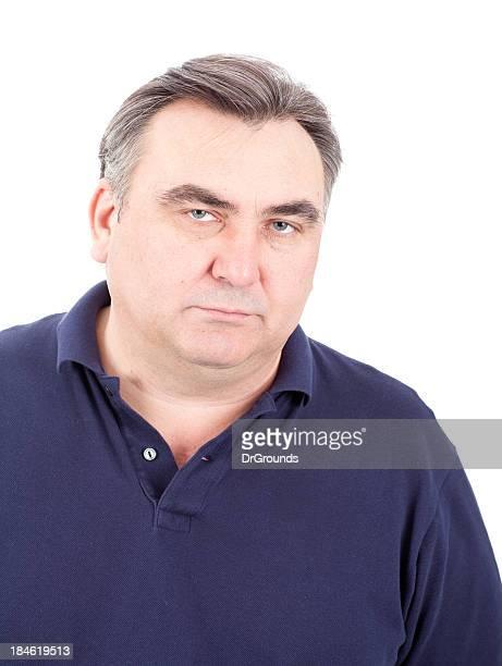 Serious mature man with sad expression
