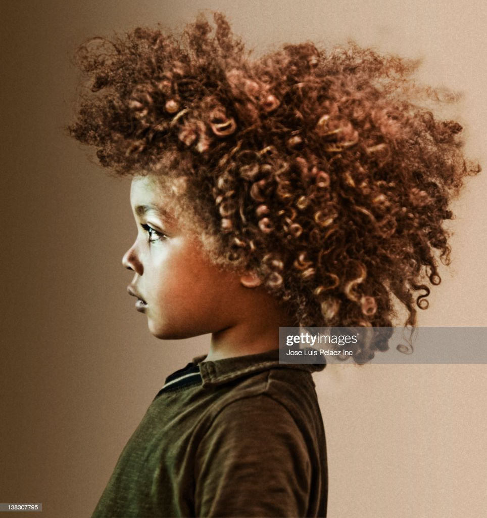 Serious mixed race boy with curly hair