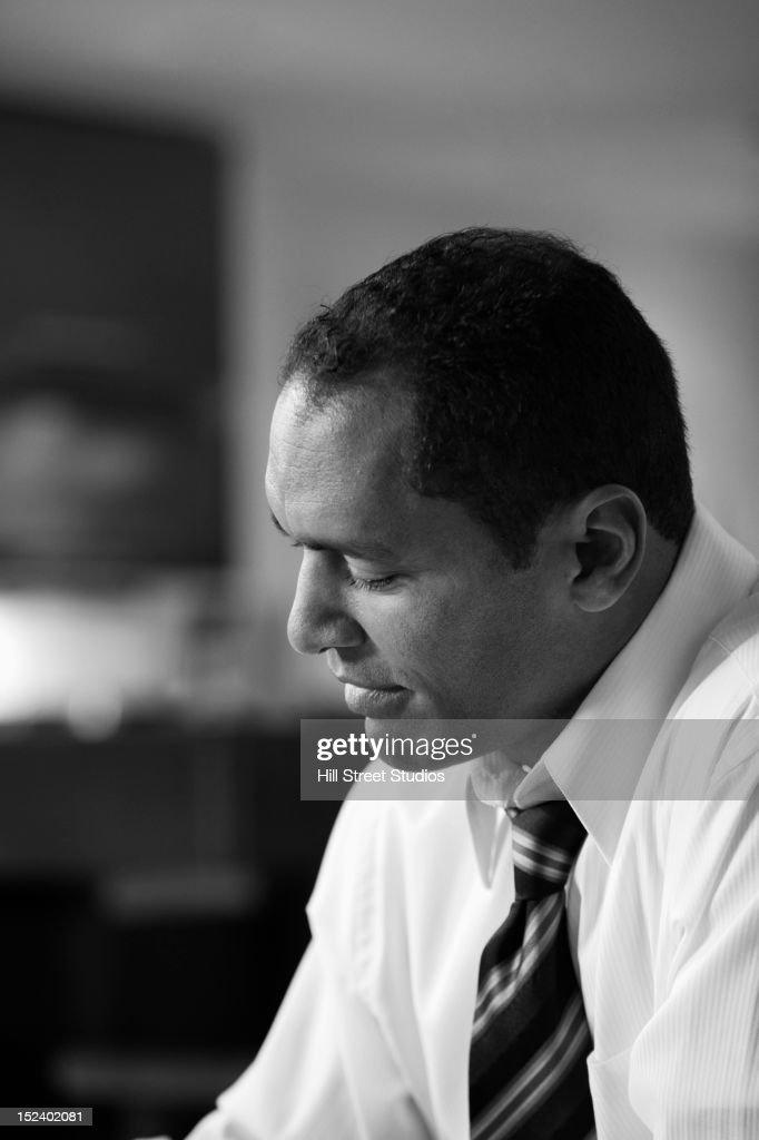 Serious mixed race businessman : Stock Photo