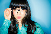 Serious mixed race woman in eyeglasses