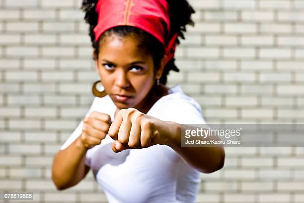 Serious Mixed Race woman posing with fists