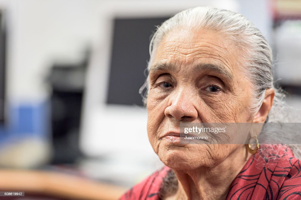 Serious old hispanic senior woman : Stock Photo