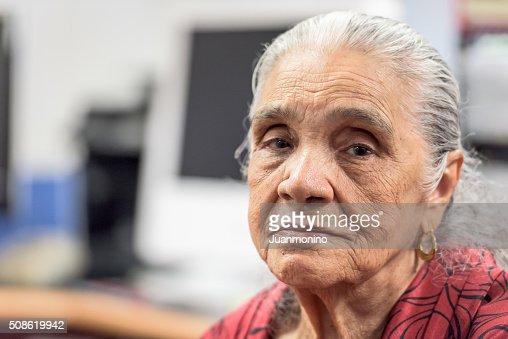 Serious old hispanic senior woman : Stock Photo