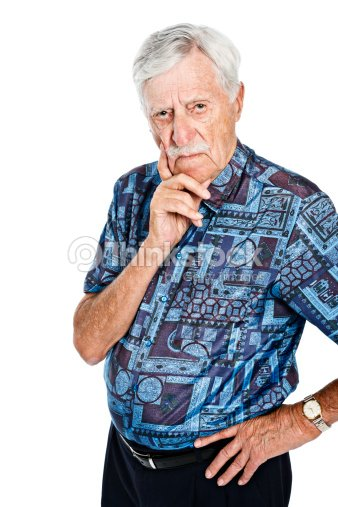 Serious Old Man Hand On Chin Looks At Camera Stock Photo Thinkstock