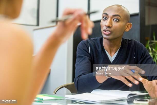 Serious people talking in meeting