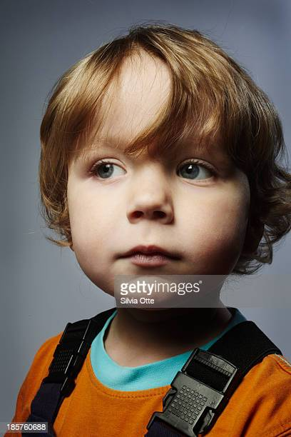 serious portrait of a 3 year old boy