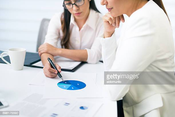 Serious professional workers looking at document