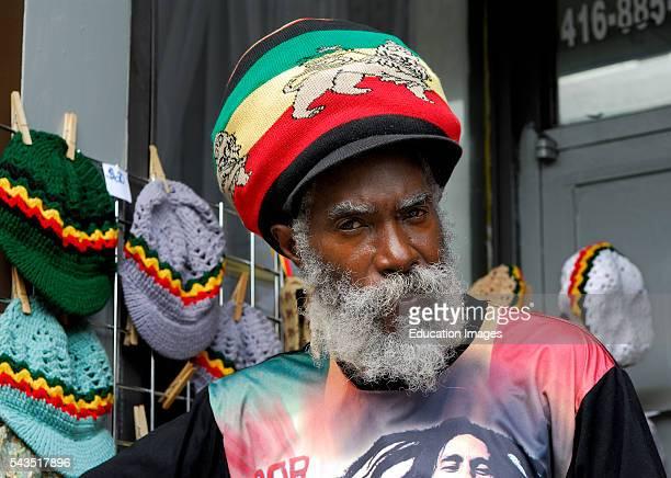 Serious Rasta man hat salesman at Kensington Market