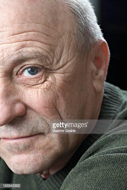 A serious senior man, close-up