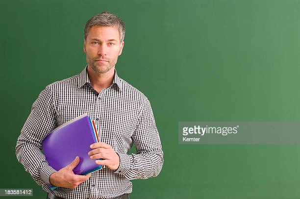 serious teacher at blackboard