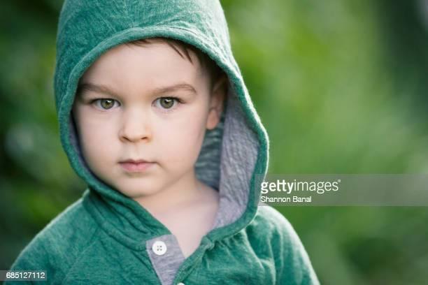 Serious Toddler Boy Stares at Camera