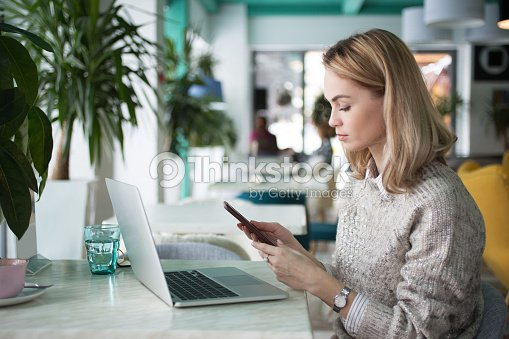 Serious woman addicted to technology : Stock Photo