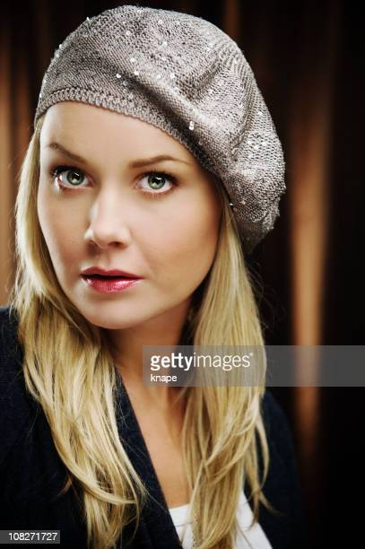 Serious woman in a fancy beret