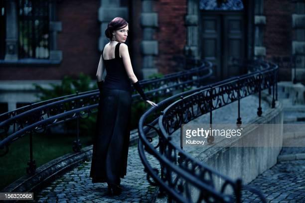 Serious woman in black dress