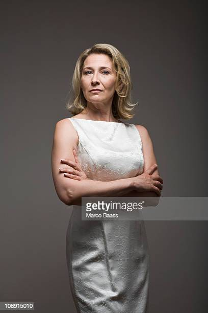 Serious woman in white dress