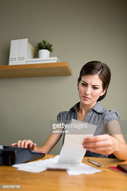 Serious woman paying bills
