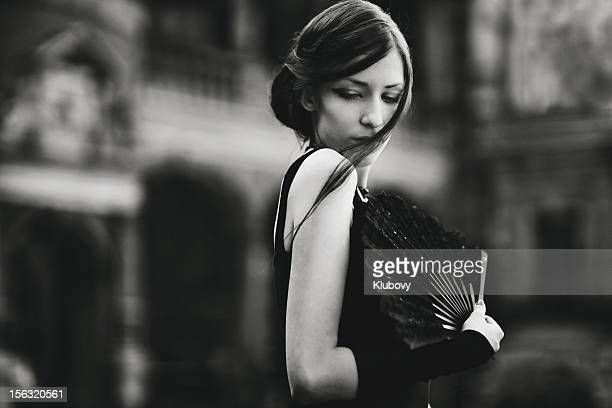 Serious woman with black fan