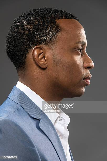 Serious young afrocaribbean man profile