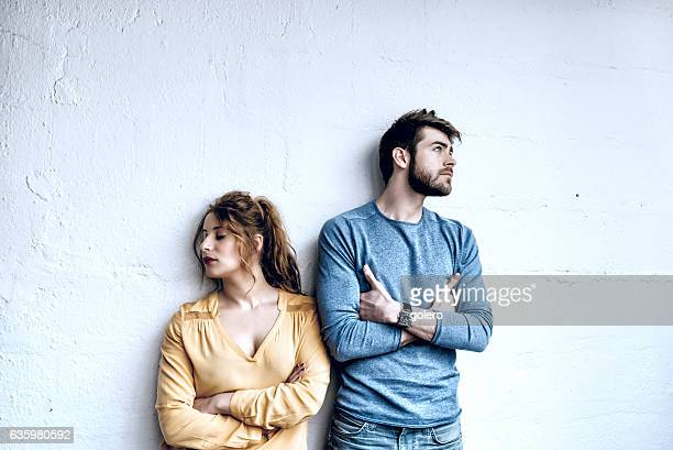 serious young french couple looking pensive in opposite directions