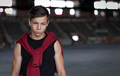 Young man in an old abandoned stadium, portrait