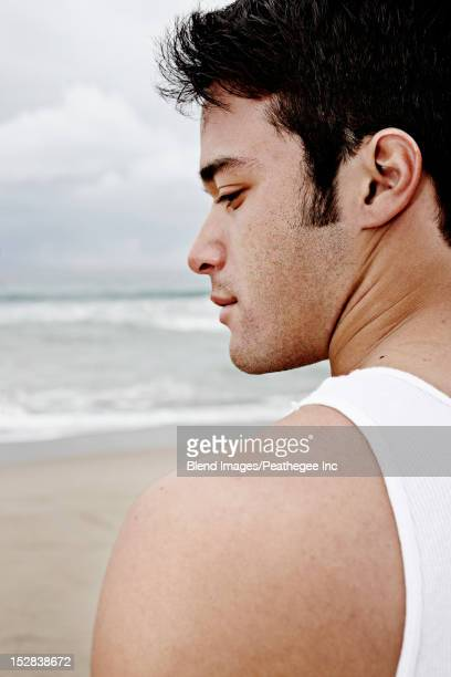 Serious young man on beach