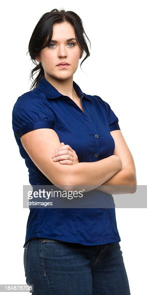 Serious Young Woman Crosses Arms