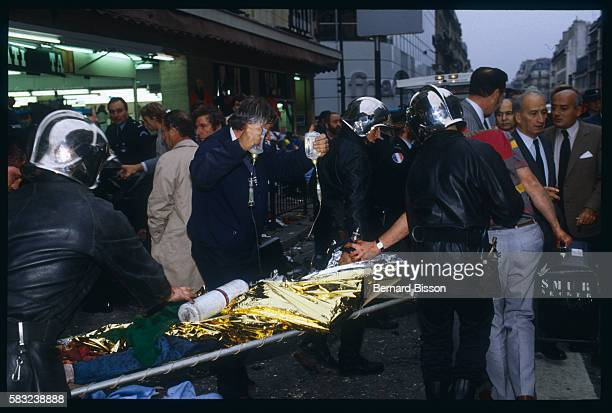 A seriously injured victim of a bomb explosion at the Tati department store on Rue de Rennes is carried away in a stretcher by police The attack...