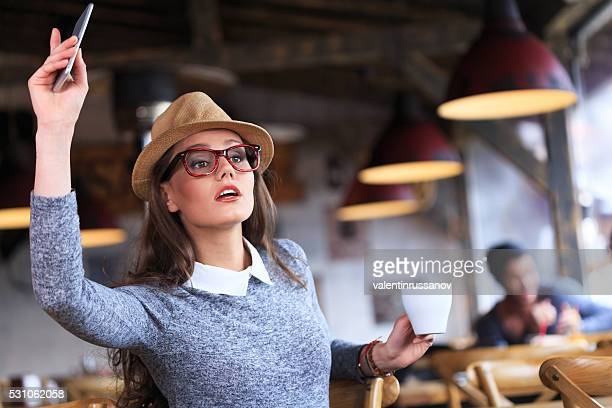 Seriuos young woman calling the waiter