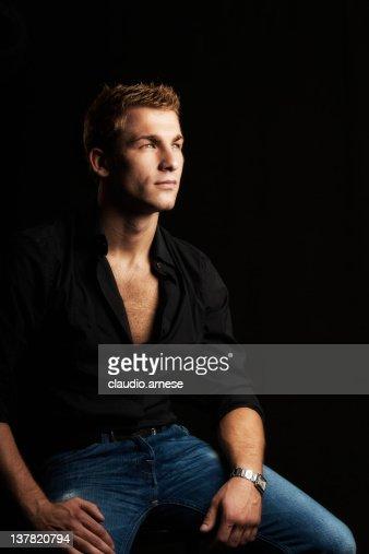 Serius Male Beauty Portrait: Black Background