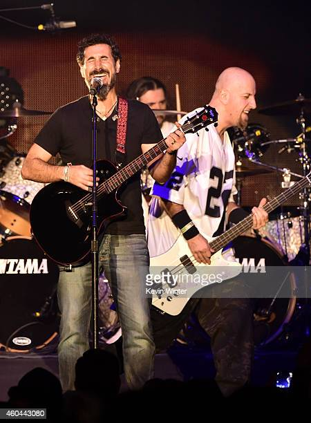 Serj Tankian and Shavo Odadjian of System of a Down perform onstage during day one of the 25th annual KROQ Almost Acoustic Christmas at The Forum on...