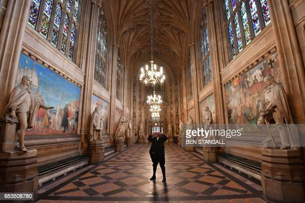TOPSHOT SerjeantatArms of the House of Commons Kamal ElHajji uses a headset to take a 360 degree virtual tour of St Stephen's Hall as he stands...