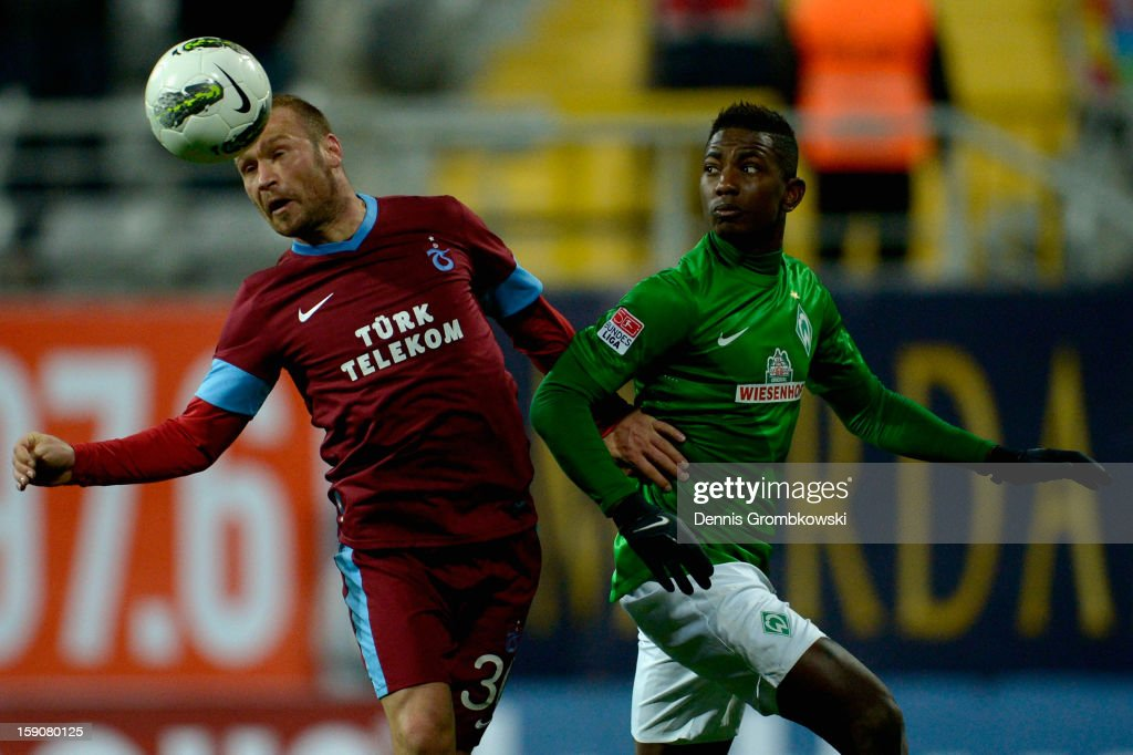 Serkan Balci of Trabzonspor and <a gi-track='captionPersonalityLinkClicked' href=/galleries/search?phrase=Eljero+Elia&family=editorial&specificpeople=2199495 ng-click='$event.stopPropagation()'>Eljero Elia</a> of Bremen battle for the ball during a friendly match between Werder Bremen and Trabzonspor at day three of the Werder Bremen Training Camp on January 7, 2013 in Belek, Turkey.