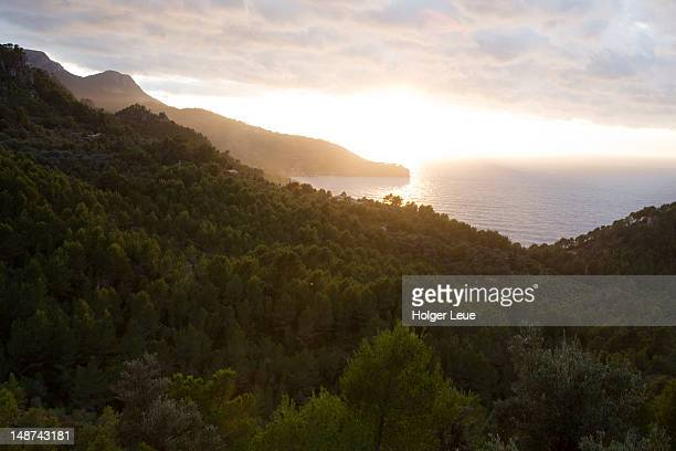 Serra de Tramuntana mountains and coastline at sunset.